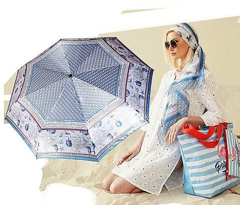 Изображение женщины с цветным зонтом