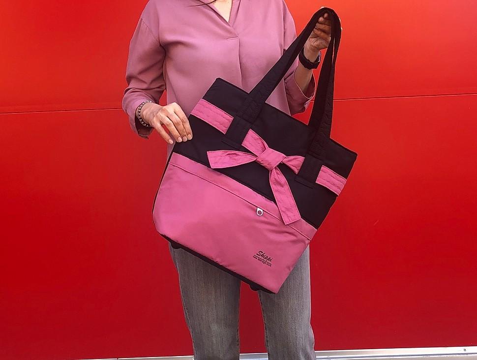 Изображение розовой сумки